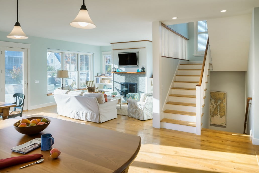 A recessed cavity was created for a flat screen television above the sand-blasted granite fireplace surround.  Built-in shelving showcases beach-combing finds and family photos.