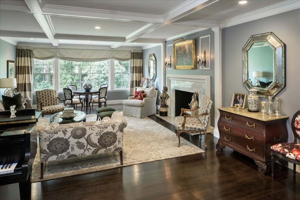 Custom columns applied to the wall set off the fireplace surround and anchor the new coffered ceiling which was created by installing beams to the ceiling.  Picture moldings applied to the wall above the fireplace set off the lights.