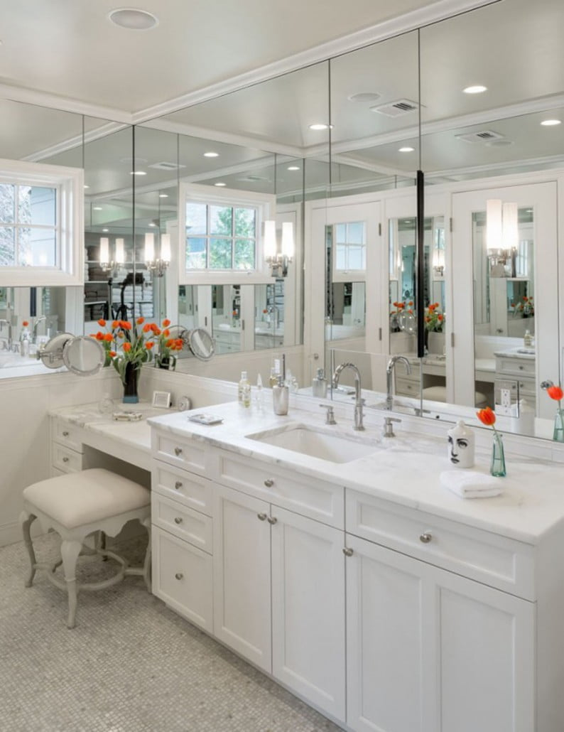 Recessed and sconces enhance the natural light from the windows.  Calcutta marble tops and custom cabinets create a separate sink with make-up vanity area.