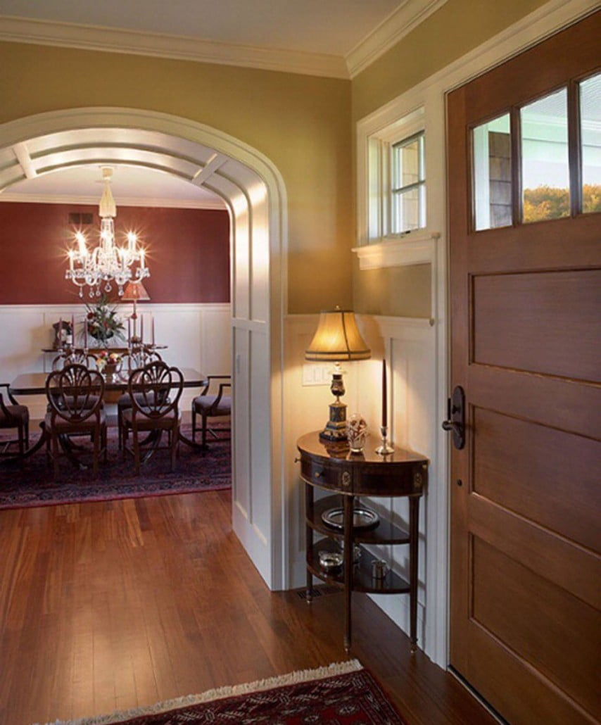 Baud Builders worked through interior trim options with the homeowner resulting in the curved archways, paneled arch and wainscot paneling in the dining room.