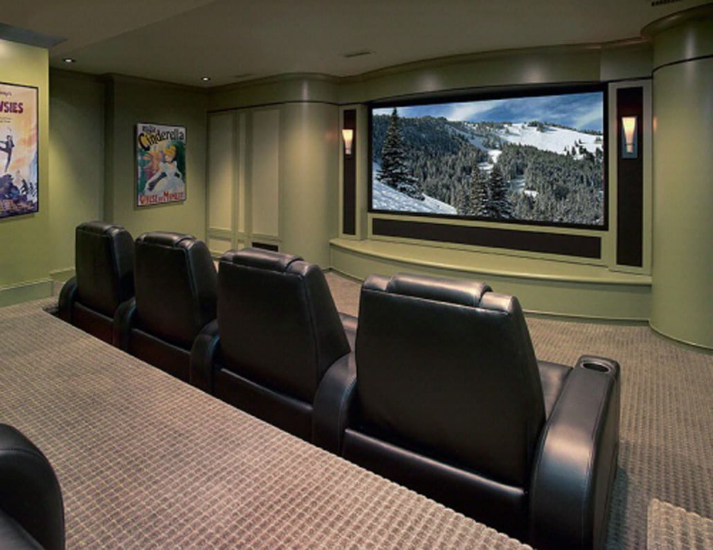 The lower level space was built out as a soundproof media room with a theatrical proscenium, elevated seating, and remote control lighting.  A storage room in the back houses the projector reducing projector noise into the room.