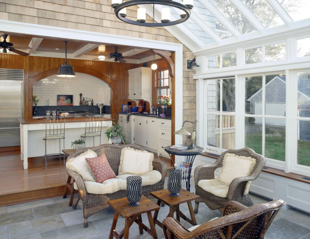 A Town & Country conservatory which was pre-crafted in England provides an all-season room where the homeowners can enjoy the beauty of the outdoors in the comfort of their home right off their kitchen.