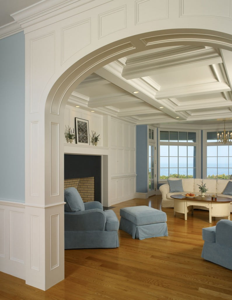 The coffered ceiling and archway used in the living room was designed in-house, fabricated in pieces off-site, then transported to be crafted on-site.