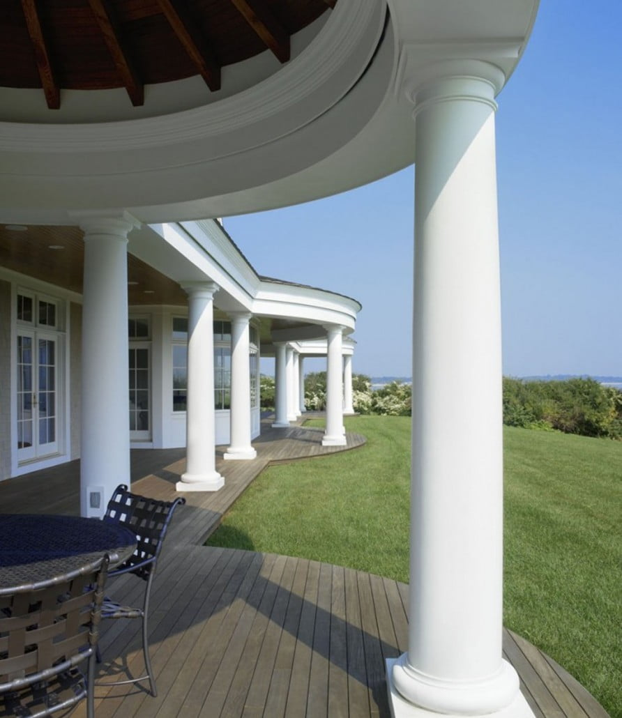 A 100' long deck with Tuscan-style columns runs the entire length of the oceanfront side. The roof, trim and assembly for the deck system was built off-site.  Three bedroom decks were built into the porch roof.