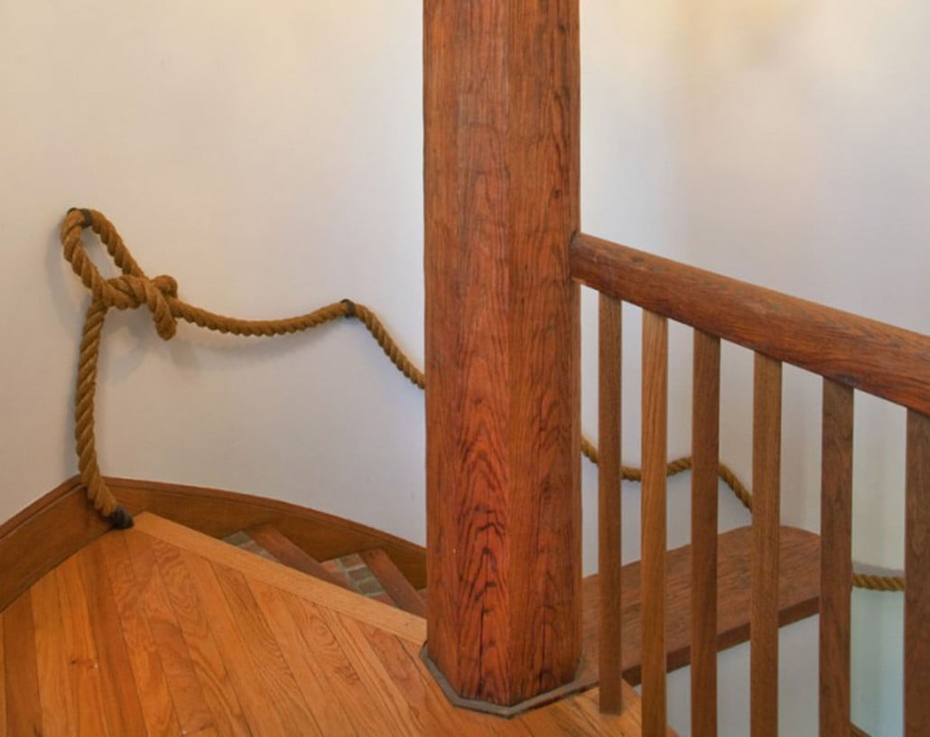 The original rope handrail was retained as well as the restored tile on the stair treads.