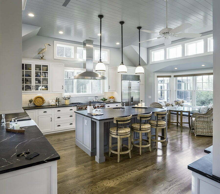 "Anderson Windows bring natural light into the new kitchen.  ""Holiday Kitchens"" with Vermont soapstone countertops give the owners plenty of prep space.  WarmBoard radiant heat keeps the space warm in winter months."