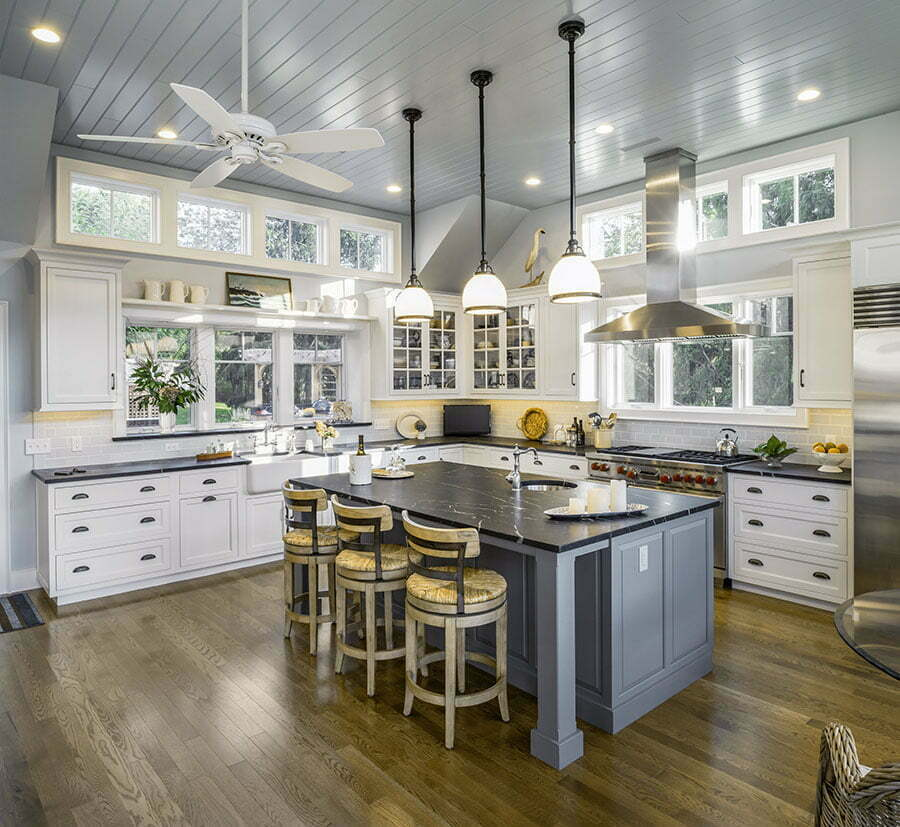 Beadboard ceilings, glass front upper cabinets and cup pulls give the kitchen a traditional feel.